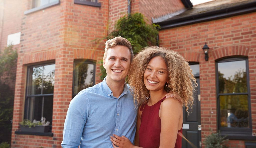 A photo of clients in front of their home can go a long way to establish credibility