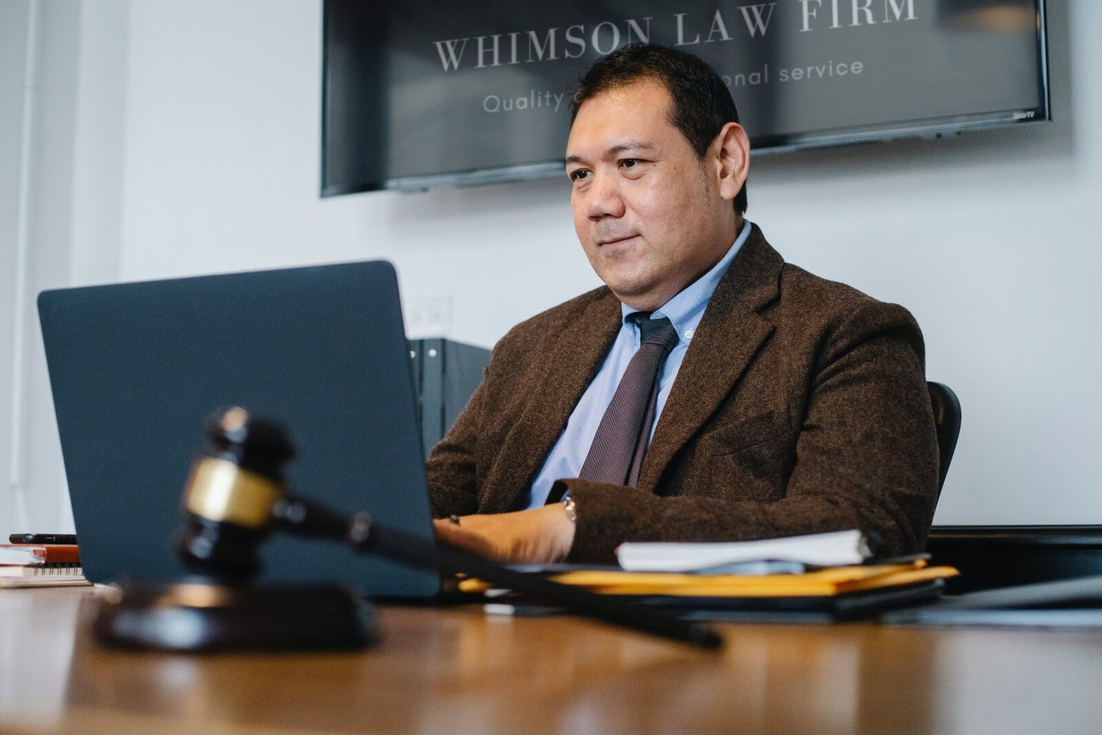 Male AAPI lawyer reviews his personal injury law firm's website
