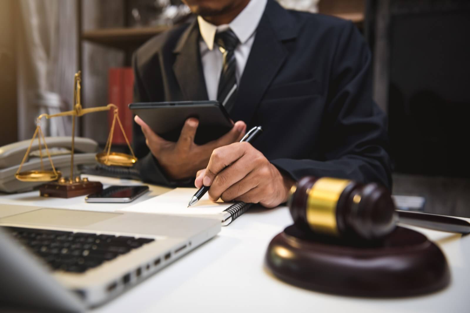 a lawyer records blog ideas on a notebook